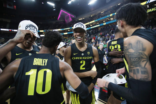 Oregon players, including Louis King (2) and Victor Bailey Jr., celebrate after defeating Washington 68-48 in an NCAA college basketball game in the final of the Pac-12 men's tournament Saturday, March 16, 2019, in Las Vegas. (AP Photo/John Locher)