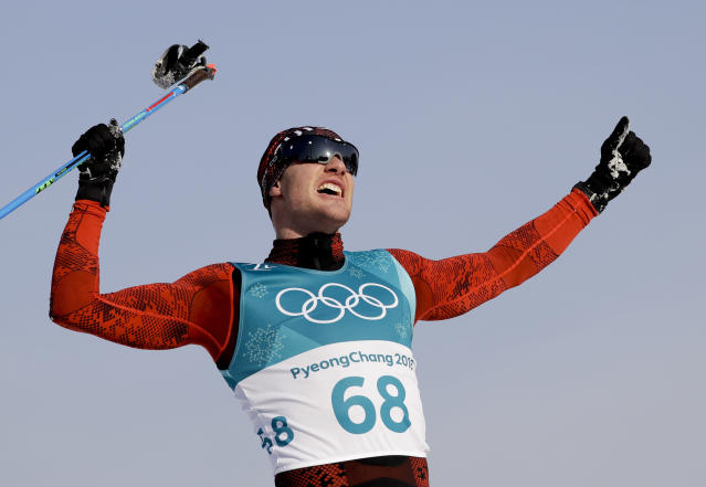 <p>Dario Cologna, of Switzerland, celebrates winning the gold medal in the men's 15km freestyle cross-country skiing competition. (AP) </p>
