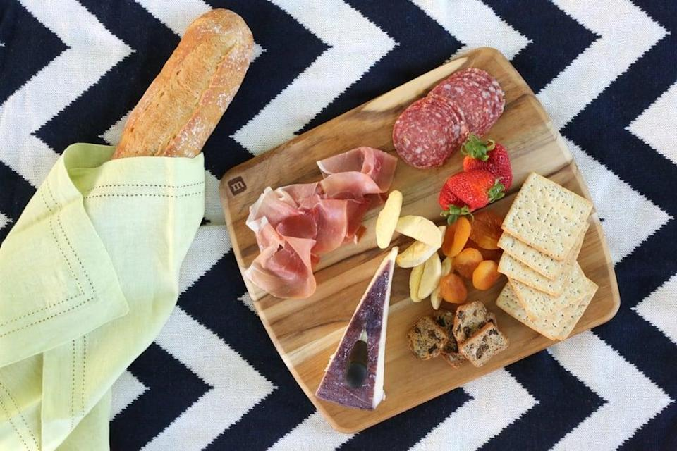 <p>There's no denying it: there's nothing more beautiful than a plate full of cheese, meat, fresh fruits, and crackers.</p>