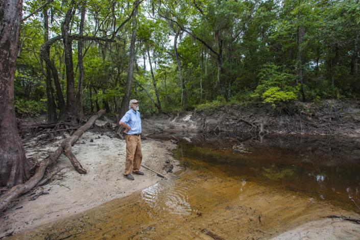 John Quarterman stands by the Withlacoochee River. (Matt Odom / for NBC News)