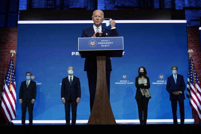 President-elect Joe Biden removes his face mask as he arrives to introduce his nominees and appointees to key national security and foreign policy posts at The Queen theater, Tuesday, Nov. 24, 2020, in Wilmington, Del. (AP Photo/Carolyn Kaster)