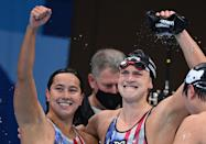 <p>First placed USA's Kathleen Ledecky (R) and second places USA's Erica Sullivan celebrate after the final of the women's 1500m freestyle swimming event during the Tokyo 2020 Olympic Games at the Tokyo Aquatics Centre in Tokyo on July 28, 2021. (Photo by Oli SCARFF / AFP)</p>