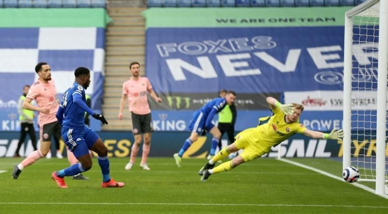 Kelechi Iheanacho (2L) scores the first of his three goals for Leicester City against Sheffield United at the weekend