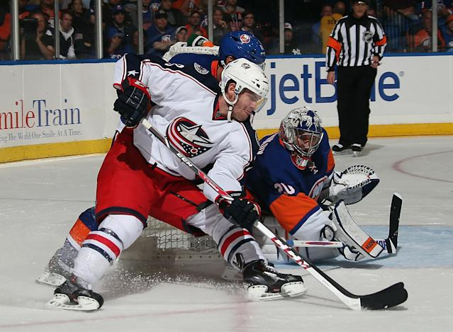 UNIONDALE, NY - OCTOBER 05: Boone Jenner #38 of the Columbus Blue Jackets carries the puck against Evgeni Nabokov #20 of the New York Islanders at the Nassau Veterans Memorial Coliseum on October 5, 2013 in Uniondale, New York. The Blue Jackets defeated the Islanders 3-2 in the shootout. (Photo by Bruce Bennett/Getty Images)