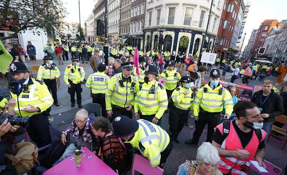 Police officers surrounded the demonstrations (PA)