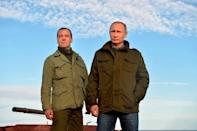 FILE PHOTO: Russian President Putin and Prime Minister Medvedev are seen during their meeting at Lipno Island in Novgorod region