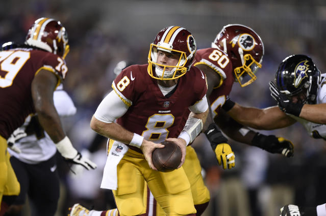 Washington Redskins quarterback Kevin Hogan (8) drops back from the line of scrimmage in the first half of a preseason NFL football gameagainst the Baltimore Ravens, Thursday, Aug. 30, 2018, in Baltimore. (AP Photo/Gail Burton)