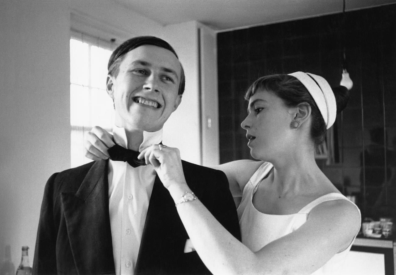 Designer and restaurateur Terence Conran of St John's Wood, London, prepares for a night out in London with his wife, journalist and author Shirley Conran, June 1955. Original Publication : Picture Post - 8083 - Twenty Shillings Or Twenty Pounds -  unpub. (Photo by Thurston Hopkins/Picture Post/Hulton Archive/Getty Images)