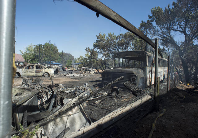 <p>Property destroyed by the fire in Moab, Utah, near Pack Creek, Wednesday, June 13, 2018. (Photo: Rick Egan/The Salt Lake Tribune via AP) </p>