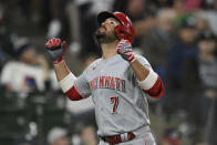 Cincinnati Reds' Eugenio Suarez (7) celebrates at home plate after hitting a solo home run during the fifth inning of a baseball game against the Chicago White Sox Tuesday, Sept. 28, 2021, in Chicago. (AP Photo/Paul Beaty)