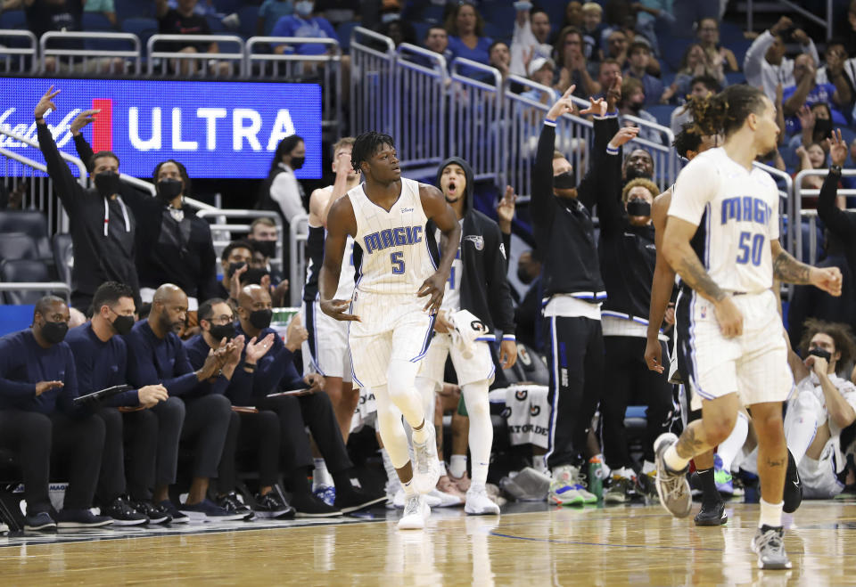 Orlando Magic bench players celebrate after teammate Mo Bamba hit a three-point basket during the second half of a preseason NBA basketball game against the San Antonio Spurs, Sunday, Oct. 10, 2021, in Orlando, Fla. (AP Photo/Jacob M. Langston)