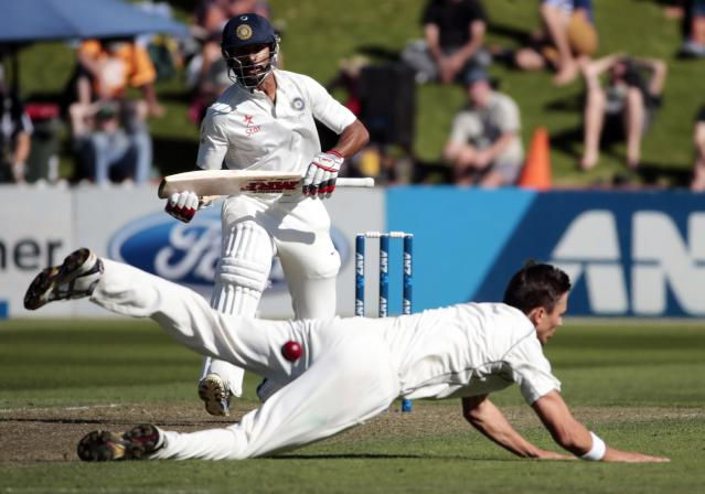 New Zealand's Trent Boult fails to field a shot from India's Shikhar Dhawan during the first innings on day one of the second international test cricket match at the Basin Reserve in Wellington, February 14, 2014. REUTERS/Anthony Phelps (NEW ZEALAND - Tags: SPORT CRICKET)