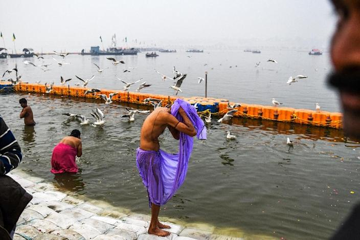 Hindus believe bathing at the Kumbh helps cleanse sins and frees the soul from the cycle of death and rebirth (AFP Photo/CHANDAN KHANNA)