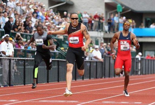 Wallace Spearmon (C) surged ahead with 50 meters remaining and took the trials title in a wind-aided 19.82 seconds