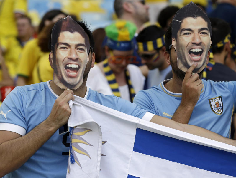 Suarez idolized, not blamed for Uruguay's exit