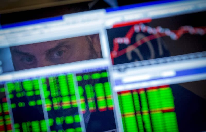 A specialist trader watches his screen on the floor of the New York Stock Exchange