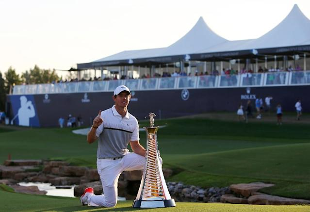 Rory McIlroy of Northern Ireland poses with his trophy after winning the DP World Tour Golf Championship in Dubai, on November 22, 2015 (AFP Photo/Marwan Naamani)