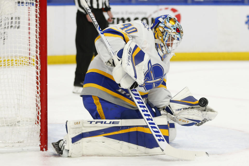 Buffalo Sabres goalie Carter Hutton (40) makes a glove save during the first period of an NHL hockey game against the Philadelphia Flyers, Saturday, Feb. 27, 2021, in Buffalo, N.Y. (AP Photo/Jeffrey T. Barnes)