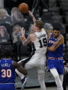 San Antonio Spurs forward Luka Samanic (19) drives to the basket against New York Knicks forward Obi Toppin (1) during the second half of an NBA basketball game in San Antonio, Tuesday, March 2, 2021. (AP Photo/Eric Gay)