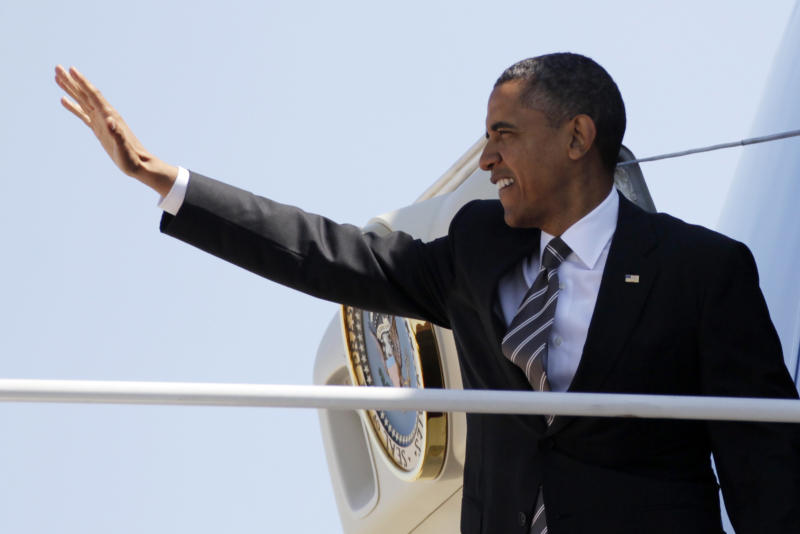 President Barack Obama waves as he boards Air Force One, Tuesday, April 24, 2012, at Andrews Air Force Base, Md., en route to North Carolina. (AP Photo/Carolyn Kaster)