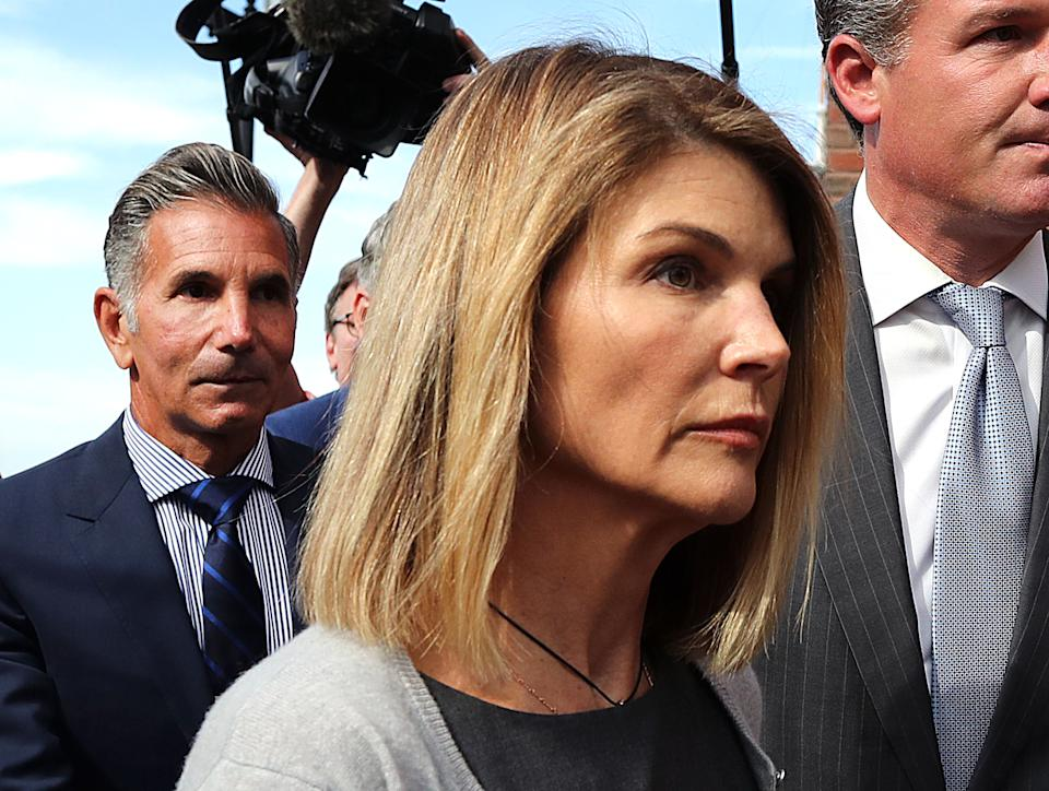 Lori Loughlin and Mossimo Giannulli, seen here in August, are expected to go to trial in October — but their attorneys keep pushing to move back the date. (Photo: John Tlumacki/The Boston Globe via Getty Images)