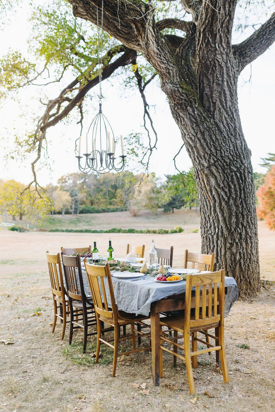 """<p>Fall weather can be unpredictable, depending on where you live, but hosting an outdoor party in fall is unexpected—and your last chance before the chilly winter months. However, always have an indoor back-up plan in case of sudden bad weather. </p><p><a class=""""link rapid-noclick-resp"""" href=""""https://www.amazon.com/Wrought-Hanging-Candelabra-Outdoor-Lighting/dp/B01H2AAB8Q/?tag=syn-yahoo-20&ascsubtag=%5Bartid%7C10050.g.1219%5Bsrc%7Cyahoo-us"""" rel=""""nofollow noopener"""" target=""""_blank"""" data-ylk=""""slk:SHOP OUTDOOR CHANDELIERS"""">SHOP OUTDOOR CHANDELIERS</a></p>"""