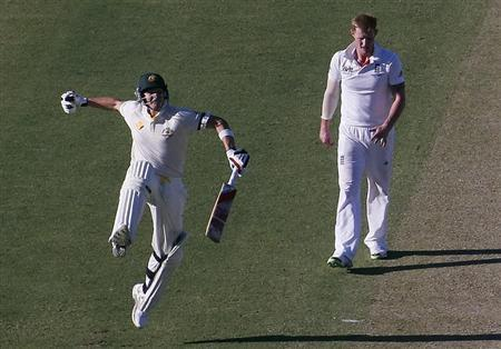 Australia's Steve Smith (L) celebrates reaching his century as England's Ben Stokes looks on during the first day of the third Ashes cricket test at the WACA ground in Perth December 13, 2013. REUTERS/David Gray