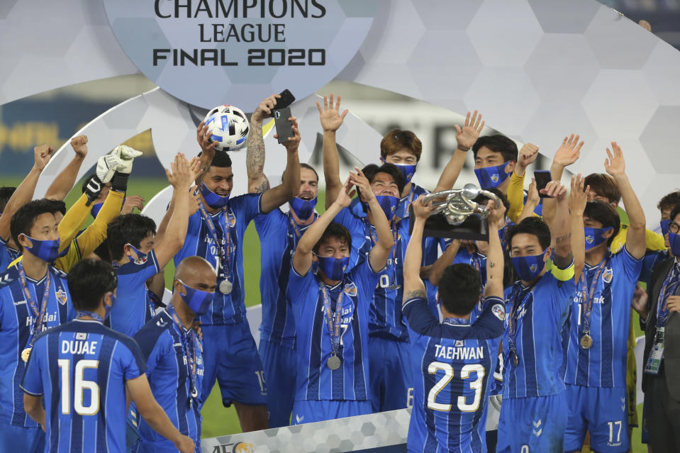 FILE - In this Dec. 19, 2020, file photo, Ulsan Hyundai's players celebrate with their trophy after the AFC Champions League final match against Persepolis in Al Wakrah, Qatar. The Asian Champions League's eastern zone competition will finally kick off after a series of delays and withdrawals. But the troubled tournament has a different look to previous editions of the continental club championship. (AP Photo/Hussein Sayed,File)