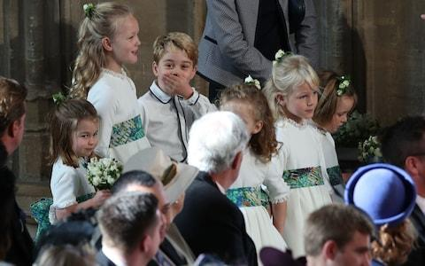 The bridesmaids and page boys, including cheeky Prince George, wait for the ceremony to start - Credit: PA