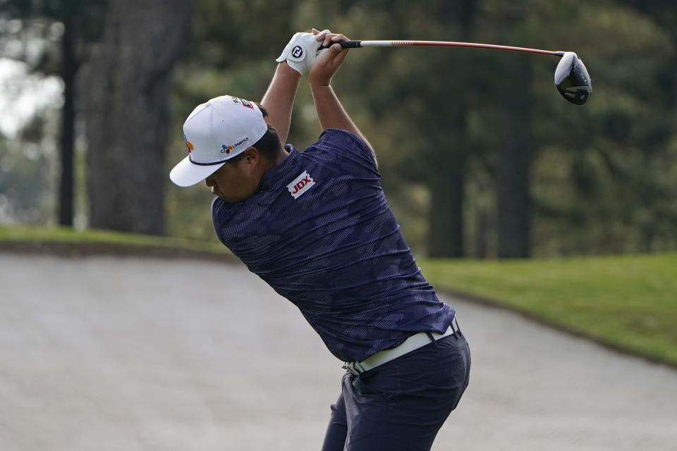 Sungjae Im, of South Korea, tees off on the third hole during the final round of the Masters golf tournament Sunday, Nov. 15, 2020, in Augusta, Ga. (AP Photo/Chris Carlson)