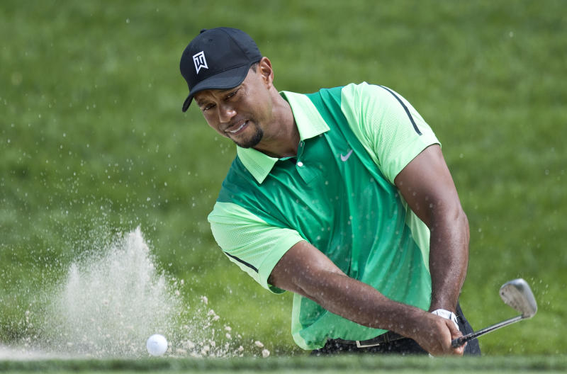 US golfer Tiger Woods swings from a bunker during a tournament at Congressional Country Club in Bethesda, Maryland on June 26, 2014