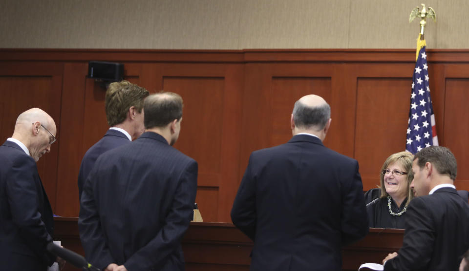 Judge Debra Nelson, second from right, greets counsel at the bench to resolve outstanding issues during George Zimmerman's trial in Seminole circuit court in Sanford, Fla. Wednesday, July 10, 2013. Zimmerman has been charged with second-degree murder for the 2012 shooting death of Trayvon Martin. (AP Photo/Orlando Sentinel, Gary W. Green, Pool)
