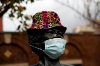 A bronze statue of late singer Ella Fitzgerald is seen wearing a hat and protective face mask, as the global outbreak of the coronavirus disease (COVID-19) continues in Yonkers, New York