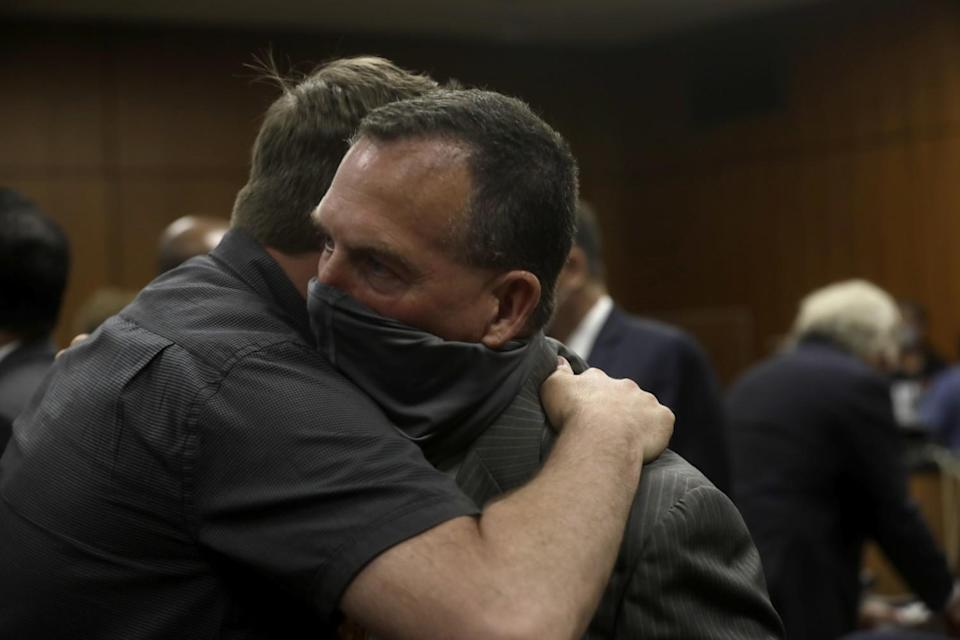 Deputy District Attorney John Lewin, right, is congratulated after New York real estate heir Robert Durst was found guilty.