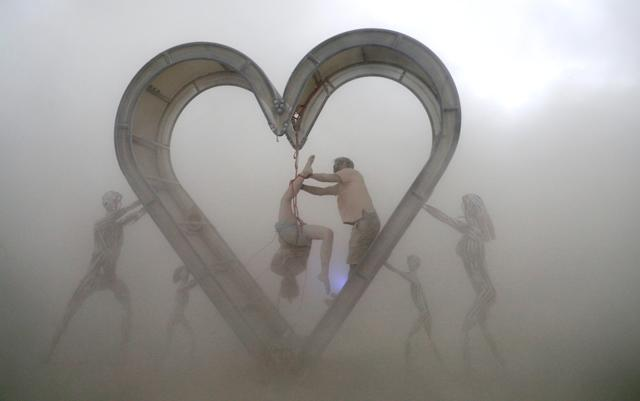 "<p>Burning Man participants perform a shibari rope scene during a driving desert dust storm inside the heart of the ""Identity Awareness – Family"" art project created by artist Shane Pitzer on the 2nd day of the annual Burning Man arts and music festival in the Black Rock Desert of Nevada, Aug. 29, 2017. (Photo: Jim Bourg/Reuters) </p>"