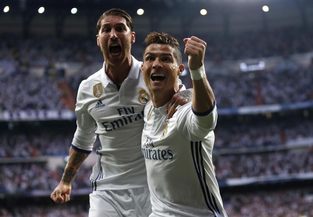 <p>Real Madrid's Cristiano Ronaldo celebrates with Real Madrid's Sergio Ramos after scoring the opening goal during the Champions League semifinals first leg soccer match between Real Madrid and Atletico Madrid at Santiago Bernabeu stadium in Madrid, Spain, May 2, 2017. (Photo: Daniel Ochoa de Olza/AP) </p>