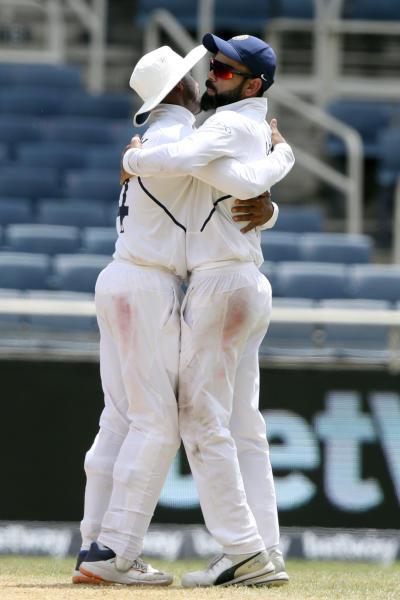 India's captain Virat Kohli and Ravindra Jadeja embrace at the end of day four of the second Test cricket match against West Indies at Sabina Park cricket ground in Kingston, Jamaica Monday, Sept. 2, 2019. India won by 257 runs. (AP Photo/Ricardo Mazalan)