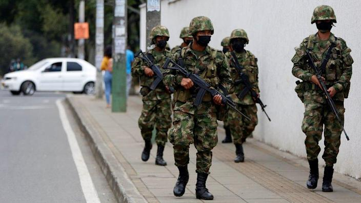 Soldiers guard the streets after Colombian President Ivan Duque ordered more military presence, one day after violent anti-government protests, in Cali, Colombia