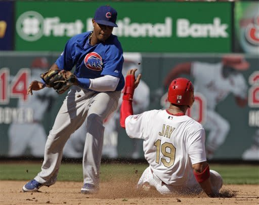 St. Louis Cardinals' Jon Jay (19) steals second as Chicago Cubs shortstop Starlin Castro applies the late tag in the fifth inning of a baseball game, Saturday, April 14, 2012 in St. Louis.(AP Photo/Tom Gannam)