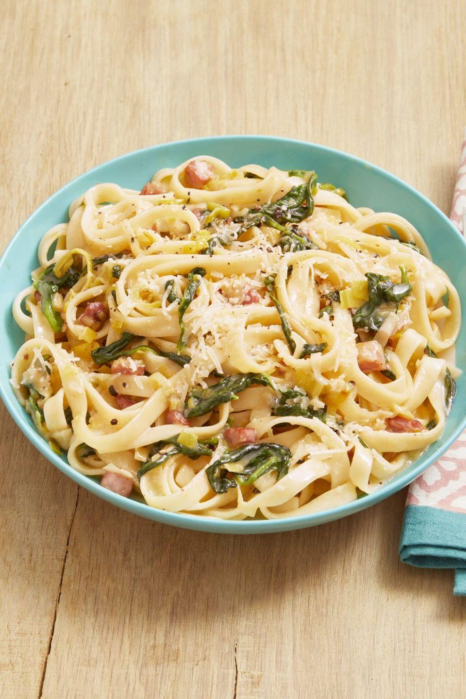 "<p>This pasta has a delicious oniony flavor thanks to the addition of fresh leeks. Oh, and it's ready in just 30 minutes.</p><p><strong><a href=""https://www.thepioneerwoman.com/food-cooking/recipes/a32477234/pasta-with-ham-leeks-and-spinach-recipe/"" rel=""nofollow noopener"" target=""_blank"" data-ylk=""slk:Get the recipe"" class=""link rapid-noclick-resp"">Get the recipe</a>.</strong></p><p><strong><a class=""link rapid-noclick-resp"" href=""https://go.redirectingat.com?id=74968X1596630&url=https%3A%2F%2Fwww.walmart.com%2Fbrowse%2Fhome%2Fthe-pioneer-woman-dishes%2F4044_623679_639999_7373615&sref=https%3A%2F%2Fwww.thepioneerwoman.com%2Ffood-cooking%2Fmeals-menus%2Fg35589850%2Fmothers-day-dinner-ideas%2F"" rel=""nofollow noopener"" target=""_blank"" data-ylk=""slk:SHOP BOWLS"">SHOP BOWLS</a><br></strong></p>"