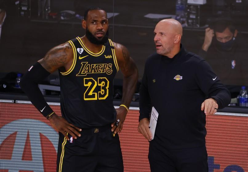 Los Angeles Lakers' LeBron James (23) talks with Jason Kidd in Game 4 of an NBA basketball first-round playoff series against the Portland Trail Blazers, Monday, Aug. 24, 2020, in Lake Buena Vista, Fla. (Kevin C. Cox/Pool Photo via AP)