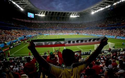 General view inside the stadium from behind the fans during the 2018 FIFA World Cup Russia group B match between Iran and Portugal at Mordovia Arena on June 25, 2018 in Saransk, Russia - Credit: Getty Images