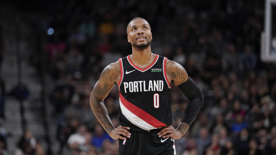 Portland Trail Blazers' Damian Lillard walks upcourt during the first half of an NBA basketball game against the San Antonio Spurs, Saturday, Nov. 16, 2019, in San Antonio. Portland won 121-116. (AP Photo/Darren Abate)