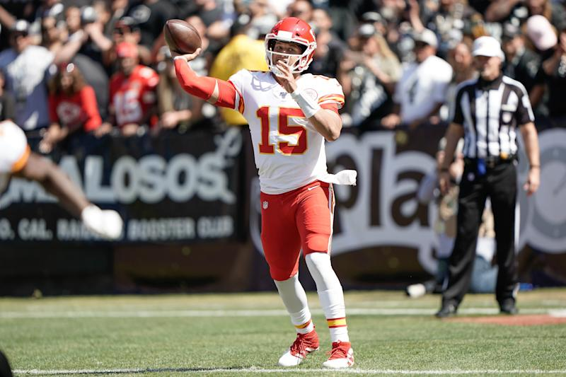 Sep 15, 2019; Oakland, CA, USA; Kansas City Chiefs quarterback Patrick Mahomes (15) throws the football against the against the Oakland Raiders during the second quarter at the Oakland Coliseum. Mandatory Credit: Stan Szeto-USA TODAY Sports