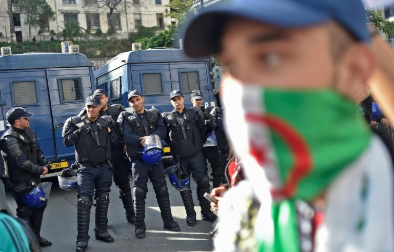 Security forces deployed across Algiers as demonstrators rallied against next week's vote