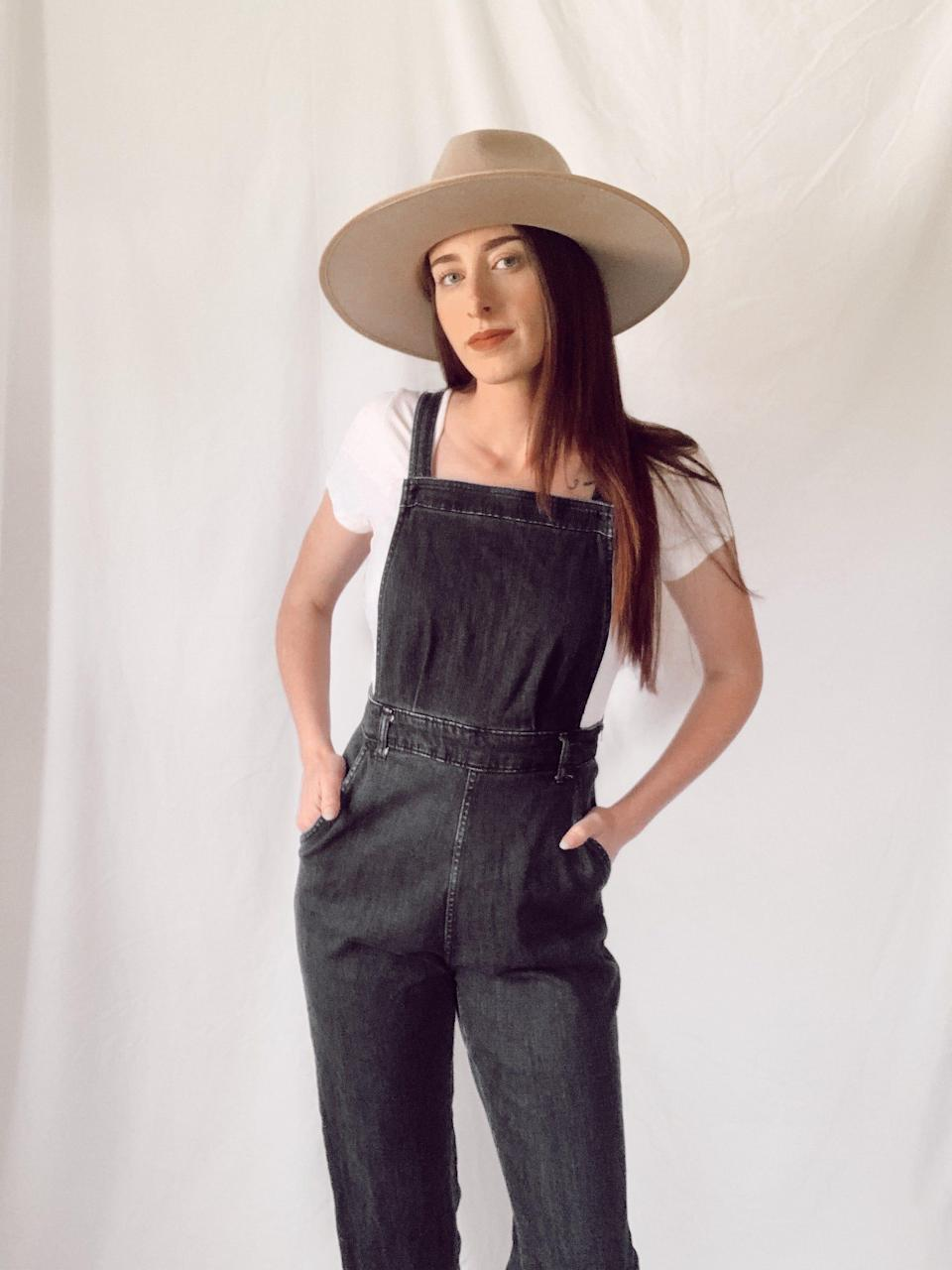 Celeste Preston models an outfit she sold from her thrift and consignment store in an effort to be more sustainable.