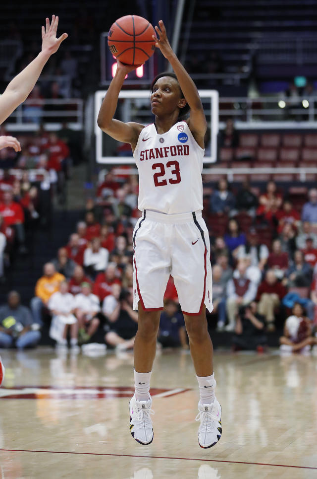 Stanford guard Kiana Williams (23) takes a 3-point shot against Gonzaga during the first half of a first-round game in the NCAA women's college basketball tournament in Stanford, Calif., Saturday, March 17, 2018. (AP Photo/Tony Avelar)