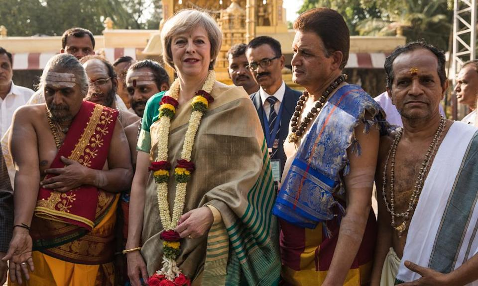 Theresa May with holy men
