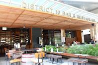 District 10 Bar & Restaurant at UE Square serves dishes finished in a wheel of cheese. (Photo: Yahoo Singapore)