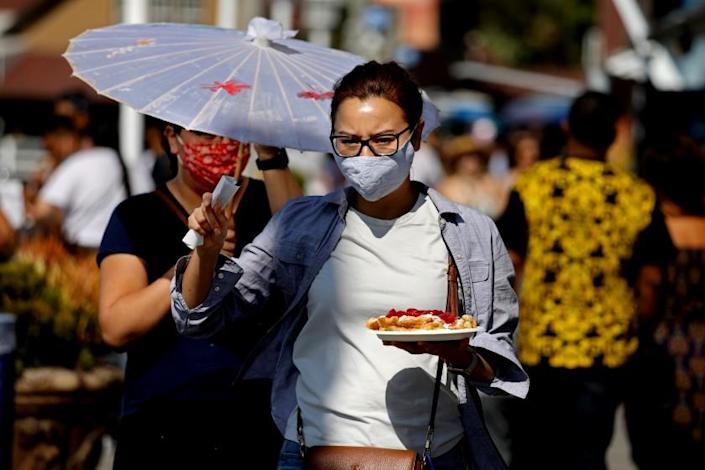 LONG BEACH, CA - JULY 18: People spend the afternoon at Shoreline Village on Sunday, July 18, 2021 in Long Beach, CA. Los Angeles County on Sunday began requiring people to wear masks in indoor public places. (Gary Coronado / Los Angeles Times)